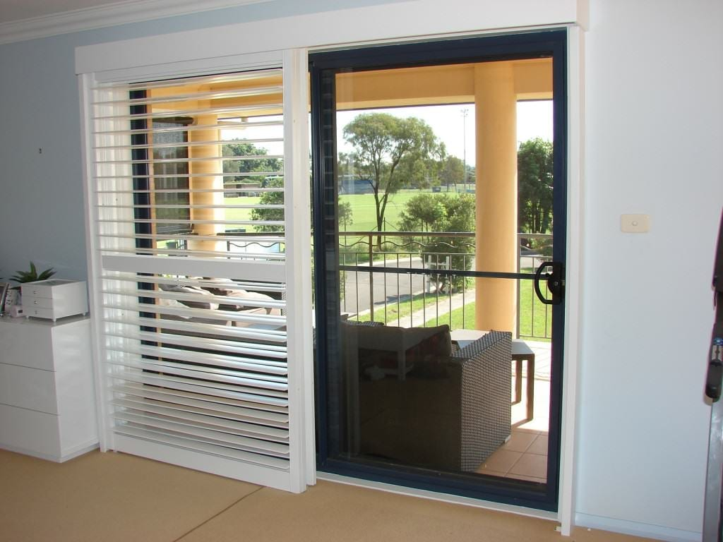Traditional And Convenient Bi Pass Shutters The Shutter Guy