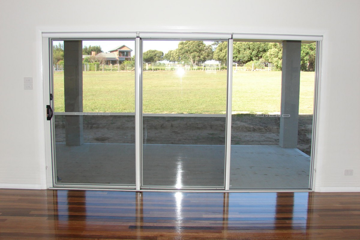 Door Blinds Roller On Triple Roller Blinds For Glass Sliding Doors 01 Troublefree And Quality Roller Blinds The Shutter Guy